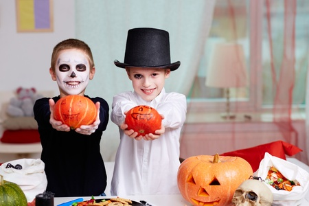 antichrist: Photo of two eerie boys with Halloween pumpkins Stock Photo