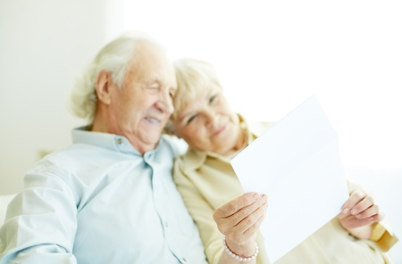 the grandfather: Image of letter being red by senior couple