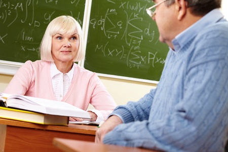congenial: Elderly people looking at each other during the break between lessons Stock Photo