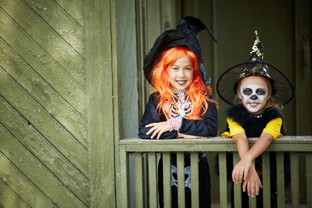 antichrist: Portrait of two Halloween girls looking at camera Stock Photo