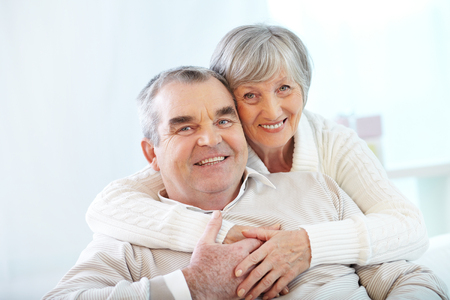 old couple: Portrait of a happy senior couple looking at camera