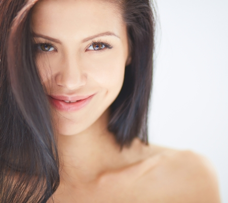 beautiful brunette: Smiling woman with dark hair looking at camera
