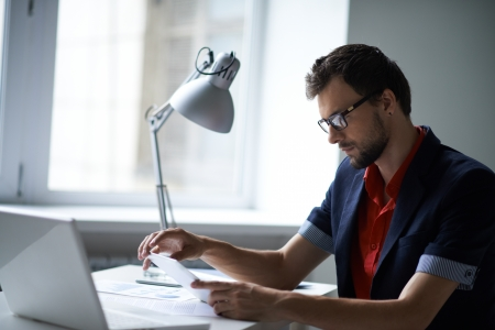 busy beard: Handsome businessman in smart casual and eyeglasses working in office