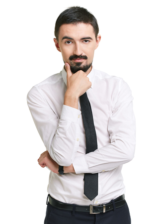 speculating: Portrait of pensive male in formalwear looking at camera
