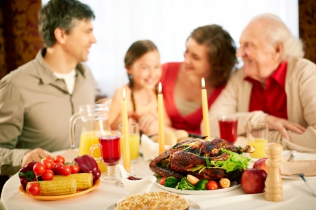 thanksgiving dinner: Image of festive table with family on background