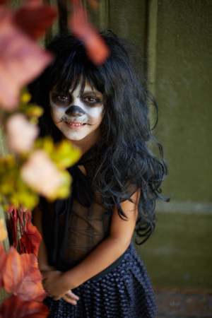 antichrist: Portrait of spooky girl in Halloween attire looking at camera