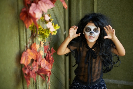 antichrist: Portrait of Halloween girl with frightening expression looking at camera