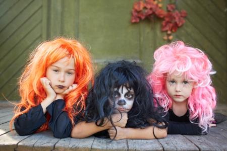 antichrist: Portrait of three Halloween girls looking at camera