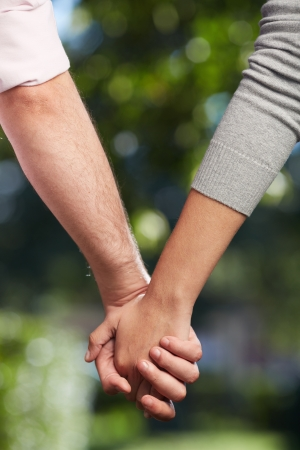 feminine hands: Conceptual image of female and male hands together  Stock Photo