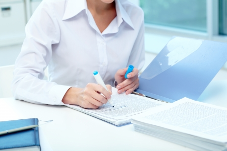proficiency: Close-up of young female writing proficiency test