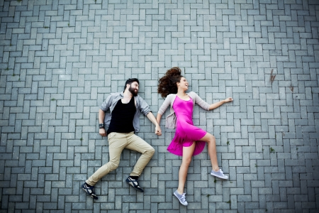 Image of affectionate dates lying on pavement