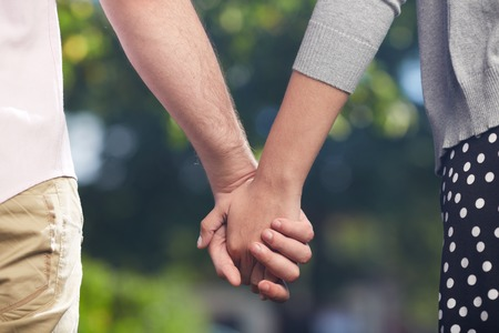 couple holding hands: Conceptual image of female and male hands together  Stock Photo
