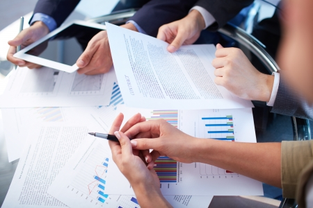 Image of human hands during paperwork at meeting  photo