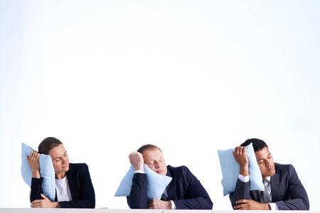 siesta: Portrait of smart business partners in formalwear sleeping on pillows