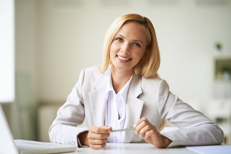 Young businesswoman looking at camera with toothy smile photo
