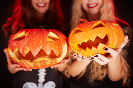 antichrist: Photo of carved Halloween pumpkins on female palms Stock Photo