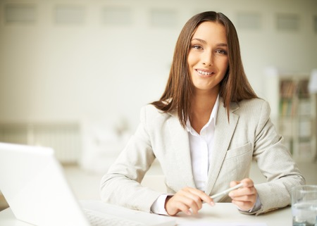 Smiling businesswoman in formalwear looking at camera photo
