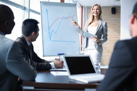 men ideas: Image of happy teacher talking to business people at seminar Stock Photo
