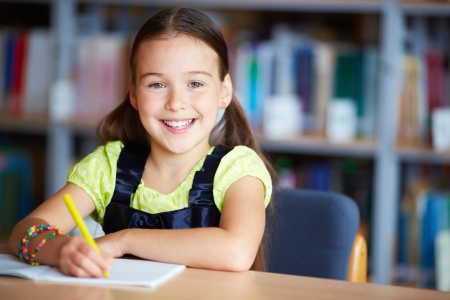 lifestyle looking lovely: Portrait of a lovely girl sitting in library