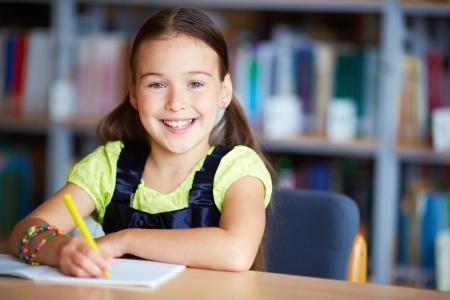 lovely girl: Portrait of a lovely girl sitting in library