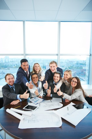 Group of business partners sitting at workplace in office photo