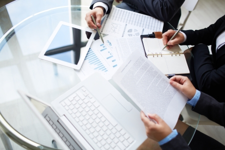 Image of human hands during paperwork at meeting  Stock Photo