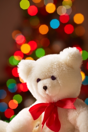 Image of white soft toy bear on sparkling background photo