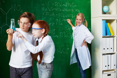 chemistry lesson: Group of schoolchildren working at chemistry lesson