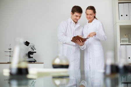 clinician: Two scientists working in lab