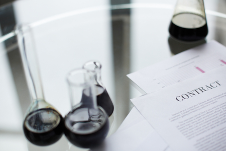 drug discovery: Test-tubes with liquid oil over contract in laboratory