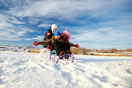 winterwear: Friendly kids in winterwear having happy time outside