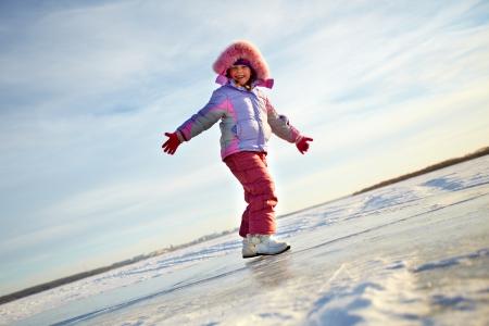 winterwear: Happy girl in winterwear looking at camera outside
