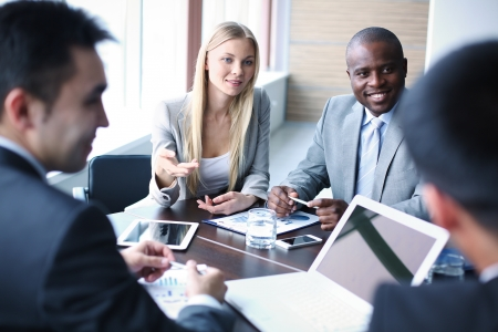 african business man: Image of business people listening and talking to their colleague at meeting
