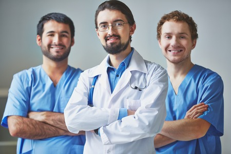 Portrait of three clinicians in uniform looking at camera photo