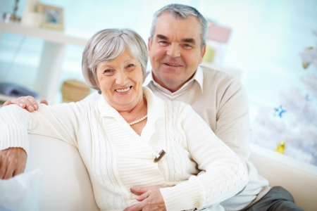 Portrait of a happy senior couple looking at camera and smiling  Stock Photo