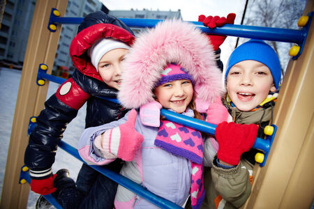 Happy children looking at camera in winter photo