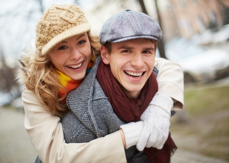 Image of affectionate couple looking at camera in park photo