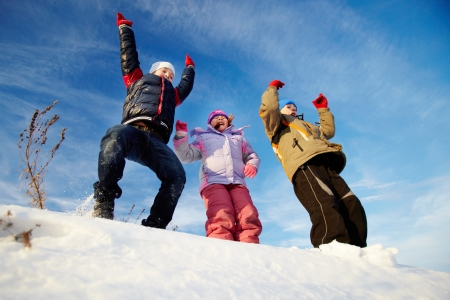 Joyful kids in winterwear having happy time outside in winter photo