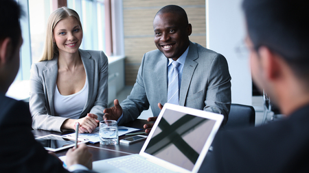 african business: Image of business people listening and talking to their colleague at meeting