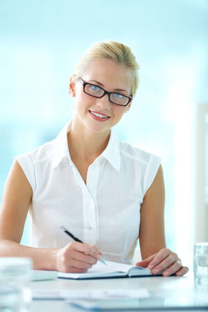 Portrait of happy businesswoman looking at camera photo
