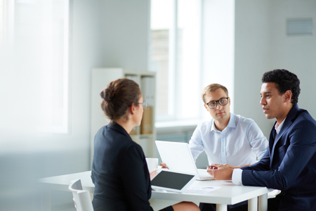competitive business: Portrait of smart business partners communicating at meeting
