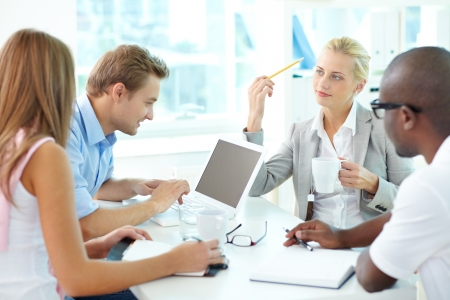 Group of friendly businesspeople having meeting photo