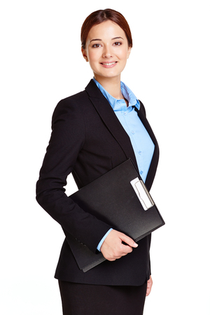 Portrait of young businesswoman with clipboard looking at camera Stock Photo