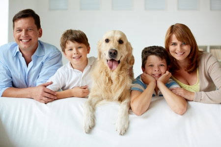 look inside: Portrait of happy family with their pet looking at camera