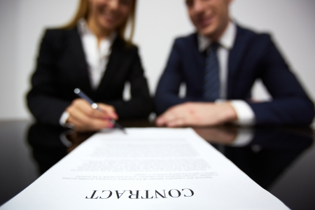 Image of human hands during signing contract photo