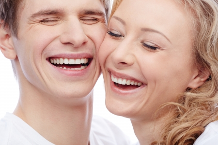 girl bonding: Faces of amorous young couple laughing with closed eyes