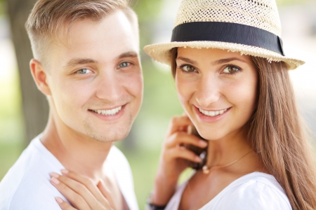 women and men: Happy girl and her boyfriend looking at camera with smiles