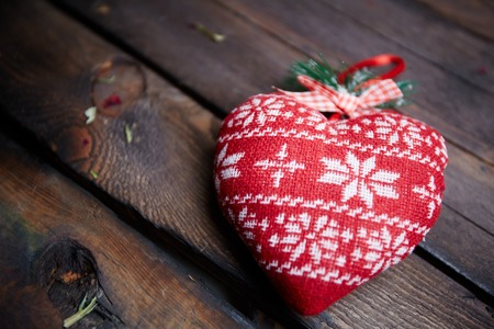 Image of red heart made of fabric on wooden background photo