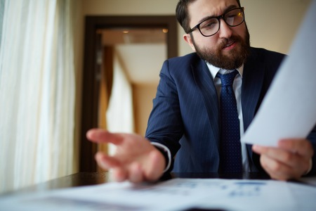 speculating: Elegant businessman working with document in office Stock Photo