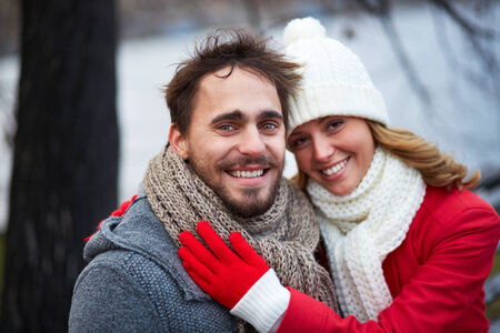 gloved: Image of affectionate couple in warm clothes outside